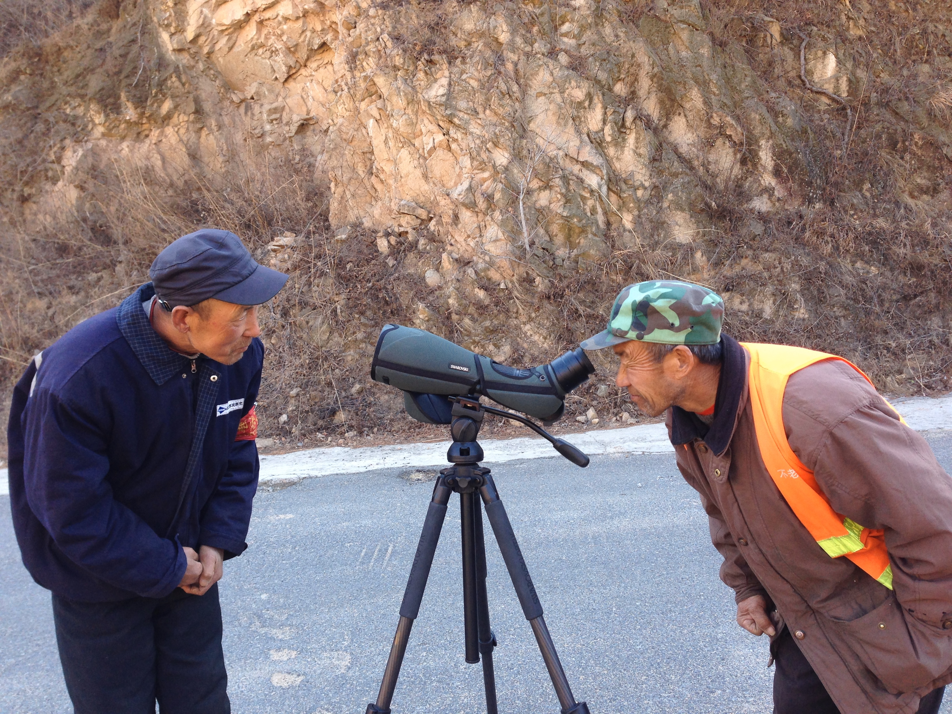 Is it a gun? A camera? Introducing the locals to birding at Miyun Reservoir.