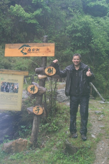 The author, having safely completed the hike at Tangjiahe.