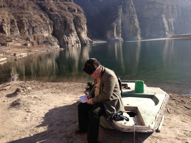 Taking notes at the Wallcreeper site.  The Rt Hon gentleman is a true birder!