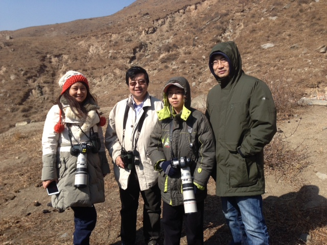 The Wang family, shortly after connecting with the male PRZEVALSKI'S REDSTART..  smiles all round!